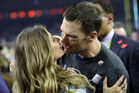 New England Patriots' Tom Brady kisses his wife Gisele Bundchen after defeating the Atlanta Falcons in overtime at the NFL Super Bowl 51. Photo / AP