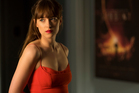 Dakota Johnson as Anastasia Steele in Fifty Shades Darker, the sequel to Fifty Shades of Grey that critics say is underwhelming. Photo/AP