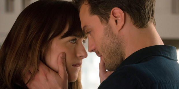 """This image released by Universal Pictures shows Dakota Johnson as Anastasia Steele, left, and Jamie Dornan as Christian Grey in """"Fifty Shades Darker."""" (Doane Gregory/Universal Pictures via A"""
