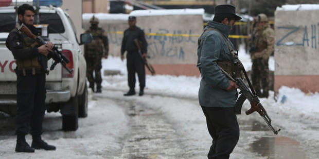Security personnel stand guard at the site of a suicide attack on the Supreme Court in Kabul, Afghanistan. Photo / AP