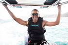 In this recent but undated photo made available by Virgin.com, former US President Barack Obama prepares to kitesurf during his stay on Moskito Island, British Virgin Islands. Photos / AP