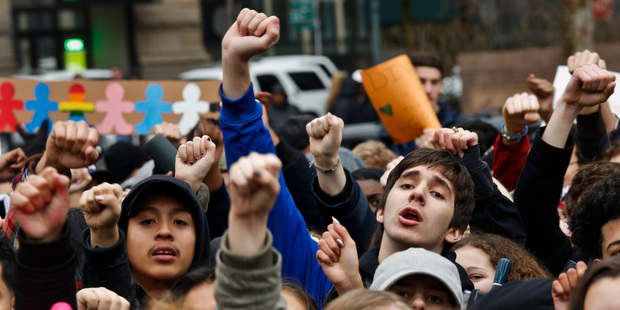 Students from high schools and colleges throughout New York city protest during a rally against President Donald Trump's executive order banning travel from seven Muslim-majority countries. Photo / AP