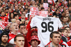 Liverpool fans hold banners in protest against the Sun newspaper and show support for the 96 fans who died in the Hillsborough disaster. Photo/Getty Images