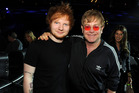 Musicians Ed Sheeran (L) and Elton John pose backstage during the 55th Annual GRAMMY Awards. Photo / Getty