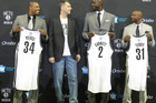 Brooklyn Nets majority owner Mikhail Prokhorov joins Kevin Garnett, Paul Pierce and Jason Terry during a press conference. Photo/Getty Images