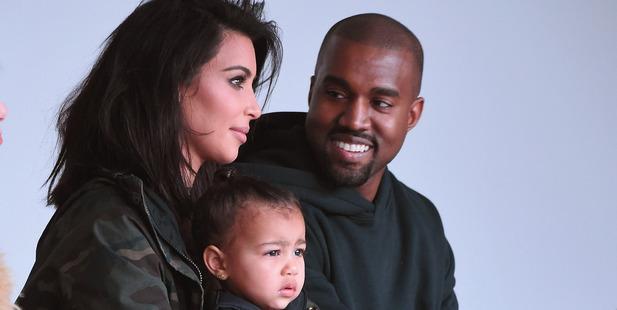 Kim Kardashian, North West and Kanye West attend a fashion show. Photo / Getty