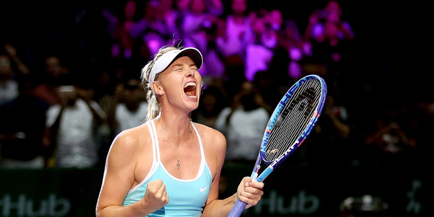 Maria Sharapova celebrates against Simona Halep during the BNP Paribas WTA Finals. Photo / Getty Images