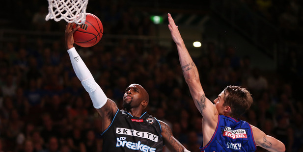 Kevin Dillard of the New Zealand Breakers goes for the basket under pressure from Nathan Sobey of the Adelaide 36ers. Photo / Getty Images
