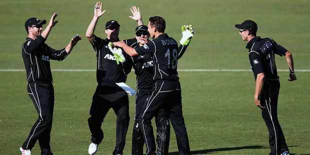 Trent Boult celebrates with teammates. Photo / Getty