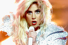 Lady Gaga's Super Bowl performance took a toll emotionally, says a source. Photo/Getty