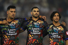 Indigenous team-mates Andrew Fifita, Greg Inglis and Johnathan Thurston line up before the NRL All Stars match. Photo/Getty Images