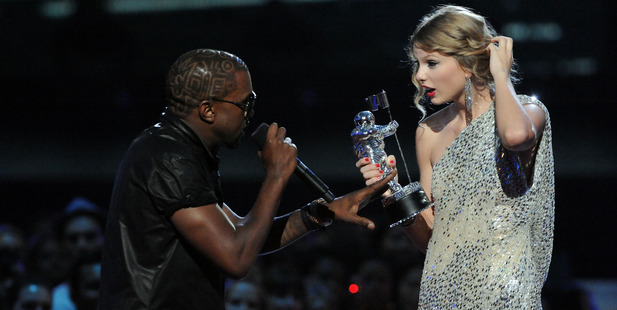 Kayne West (L) jumps onstage as Taylor Swift accepts her award. Photo / Getty