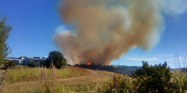 """Loading Transpower estimates 30,000 households, businesses and other power """"connections"""" in Northland cut after a large scrub fire. Photo / Ana S Kapoor"""