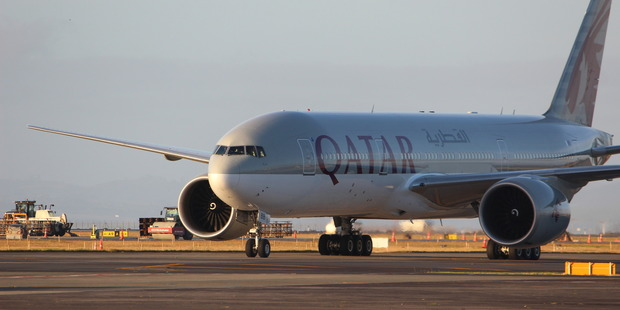 Loading Qatar Airways' Boeing 777 after touching down at Auckland Airport.  Photo / Grant Bradley
