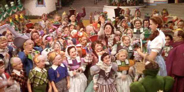 A crowd of Munchkins from a scene in The Wizard of Oz. Photo/MGM