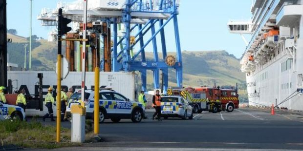 Loading Emergency services assess the scene of a gas cylinder explosion which killed a crew member on board Emerald Princess in Port Chalmers yesterday. Photo / Linda Robertson, Otago Daily Times