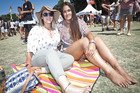 Lucy Langeluddecke (left) and Komisi Bloomfield chill out at One Love. PHOTO/ANDREW WARNER