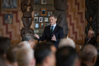 Bill English speaks inside Orakei Marae during Waitangi Day celebrations. Photo / Brett Phibbs