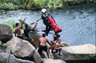 A man is winched out of Omanawa Falls after injuring himself jumping from the waterfall. Photo/Supplied