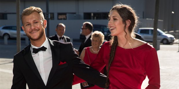 Olympian Eliza McCartney and Lukas Walton-Keimhave a laugh on the red carpet. Photo / Nick Reed