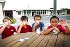 Room 4 students at Aranui School enjoy a snack break thanks to KidsCan. From left: Angel Lockwood, Tu-Kotahi Kiddie, Kaya Timoti-Hamilton and Arama Thompson. PHOTO/BEVAN CONLEY