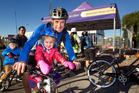SMILES: Tim Cochrane (centre) with Nina Cochrane, 3, and Alifie Cochrane, 5 at the New World pit stop for Go By Bike Day. PHOTO/BEN FRASER