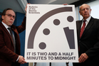 WE'RE ALL DOOMED! The Bulletin of the Atomic Scientists' Doomsday Clock is moved to two-and-a-half minutes to midnight on January 26 in Washington.
