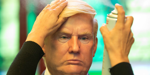 Loading A wax replica of President Donald Trump. Evidence suggested fake news sites were aiding Trump's election campaign. Photo / AP