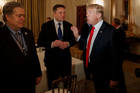 President Donald Trump talks with Tesla and SpaceX CEO Elon Musk, center, and White House chief strategist Steve Bannon during a meeting with business leaders. Photo / AP