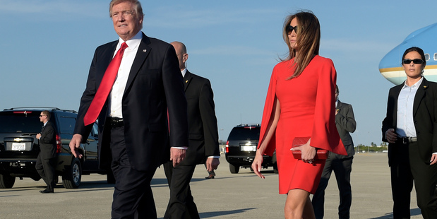 President Donald Trump walks with first lady Melania Trump. Mr trump's spokespeople said the order was to protect America. Photo / AP