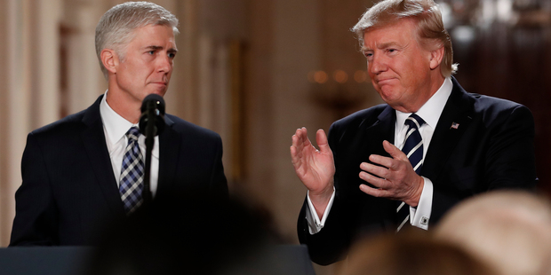 Loading President Donald Trump applauds as he stands with Judge Neil Gorsuch in East Room of the White House in Washington, after announcing Gorsuch as his nominee for the Supreme Court. Photo / AP
