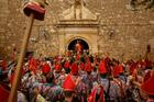 Members of the 'Endiablada' brotherhood wait for the Saint Blas procession during the traditional festival in Almonacid del Marquesado, Spain. Photo / AP