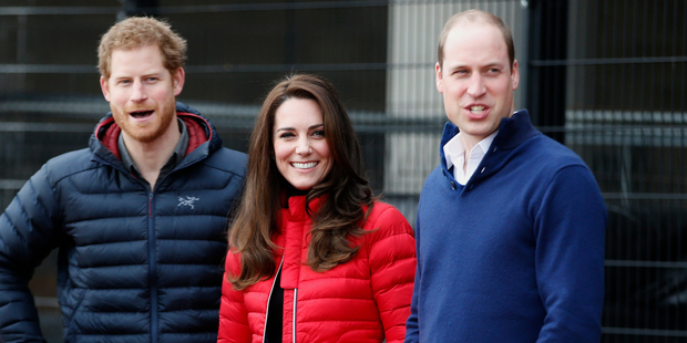 Britain's Prince William, right, Kate the Duchess of Cambridge, centre, and Prince Harry look down the track as they arrive to take part in a short relay race. Photo / AP