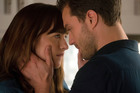 Dakota Johnson as Anastasia Steele, left, and Jamie Dornan as Christian Grey in Fifty Shades Darker.