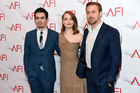 La-La Land director Damien Chazelle, left, with his stars Emma Stone and Ryan Gosling. Chazelle, 32, is a Harvard-educated son of university professors and a former jazz drummer. Photo / AP