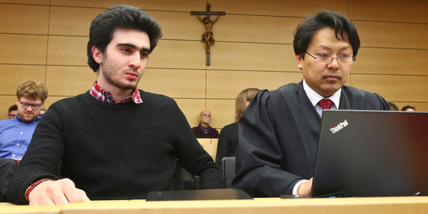 Anas Modamani, left, sits next to his lawyer Jun Chan-jo at the regional court in Wuerzburg, Germany. Photo / AP