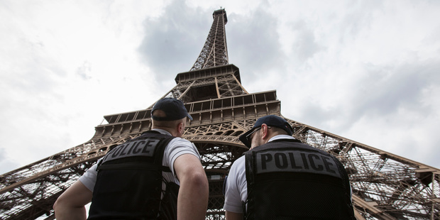Paris authorities say they are proposing to replace the metal security fencing around the Eiffel Tower with a more aesthetic glass wall. Photo / AP