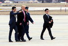 President Donald Trump walks with Japanese Prime Minister Shinzo Abe on the tarmac toward Air Force One, upon their arrival at Andrews Air Force Base on Friday. Photo / AP