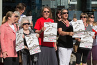 Protestors outside the hearing, held in Takapuna in December. Photo/Jason Oxenham