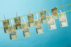 Twelve financial entities have been given an official warning for breaching anti-money laundering law. Photo/Greg Bowker.