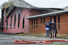 GRIEF: People hug outside the devastated St John's Church. PHOTO/FILE