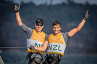 New Zealand sailors Peter Burling and Blair Tuke celebrate winning gold in the 49er class at Rio 2016.