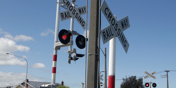The children ran across the level crossing as a train was passing, narrowly avoiding injury. Photo / File