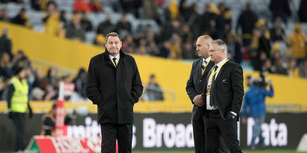 All Blacks coaches Steve Hansen and Grant Fox with one of the All Blacks security detail before the first Bledisloe match in Sydney after the spying scandal broke. Photo / Brett Phibbs