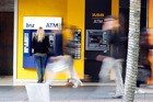In some towns there are groups of people at ATMs waiting for benefit payments to arrive.
