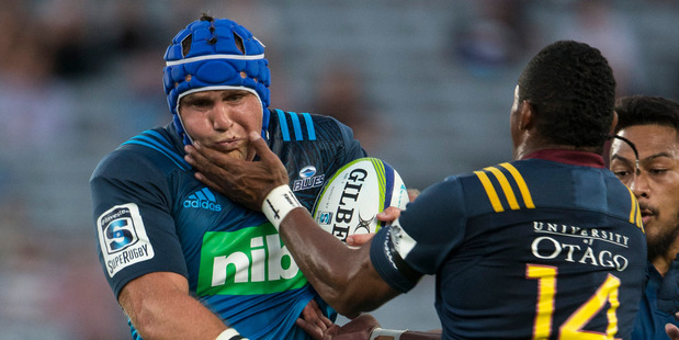 Blues hooker James Parsons cops a high shot from Highlanders wing Waisake Naholo in the opening match of 2016 Super Rugby season. Photo/Jason Oxenham