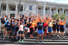 Anton Kuraia celebrates on the steps of parliament with supporters and family after a 809km walk from Whangarei to raise awareness and funds for alternative cancer treatments. PHOTO/ Kristin Edge.