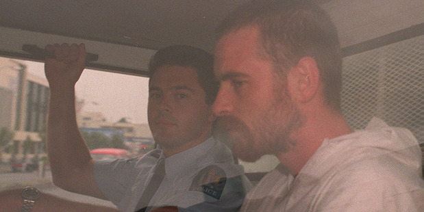 Stephen Anderson is driven from the Hamilton District Court in a police van in 1997. Photo / NZ Herald