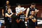Akil Mitchell of the NZ Breakers is helped off the court by his team with an eye injury during the NBL match between the Breakers and Cairns Taipans. Photo/Getty Images