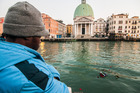 A vigil was held after the controversial death of a Gambian refugee in Venice. Photo / Getty Images